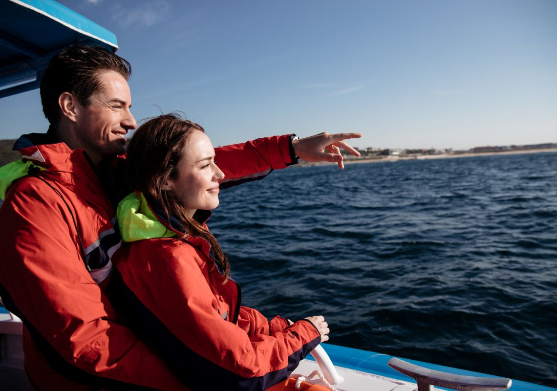 Couple enjoying a day of whale watching with CoastXP tours in Newcastle, Central Coast