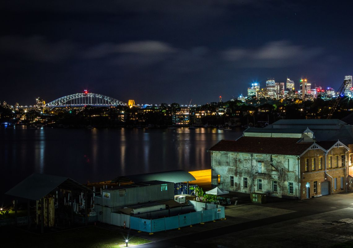View of the Sydney skyline at night as seen from Cockatoo Island in Sydney Harbour, Sydney City
