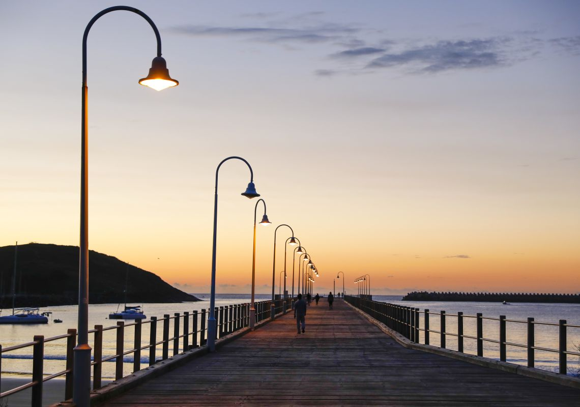 The sun rises over the pier at Jetty Beach in Coffs Harbour, North Coast