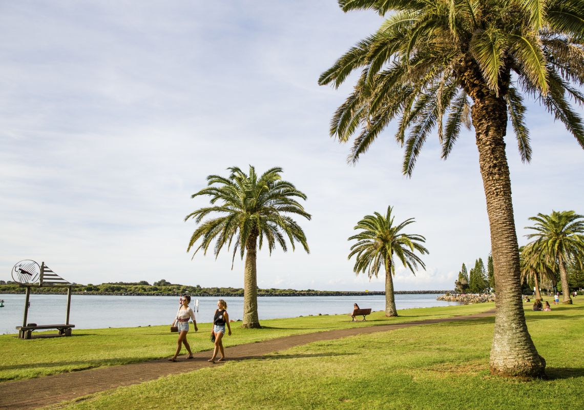Friends walking through Port Macquarie with views of the Hastings River, North Caost