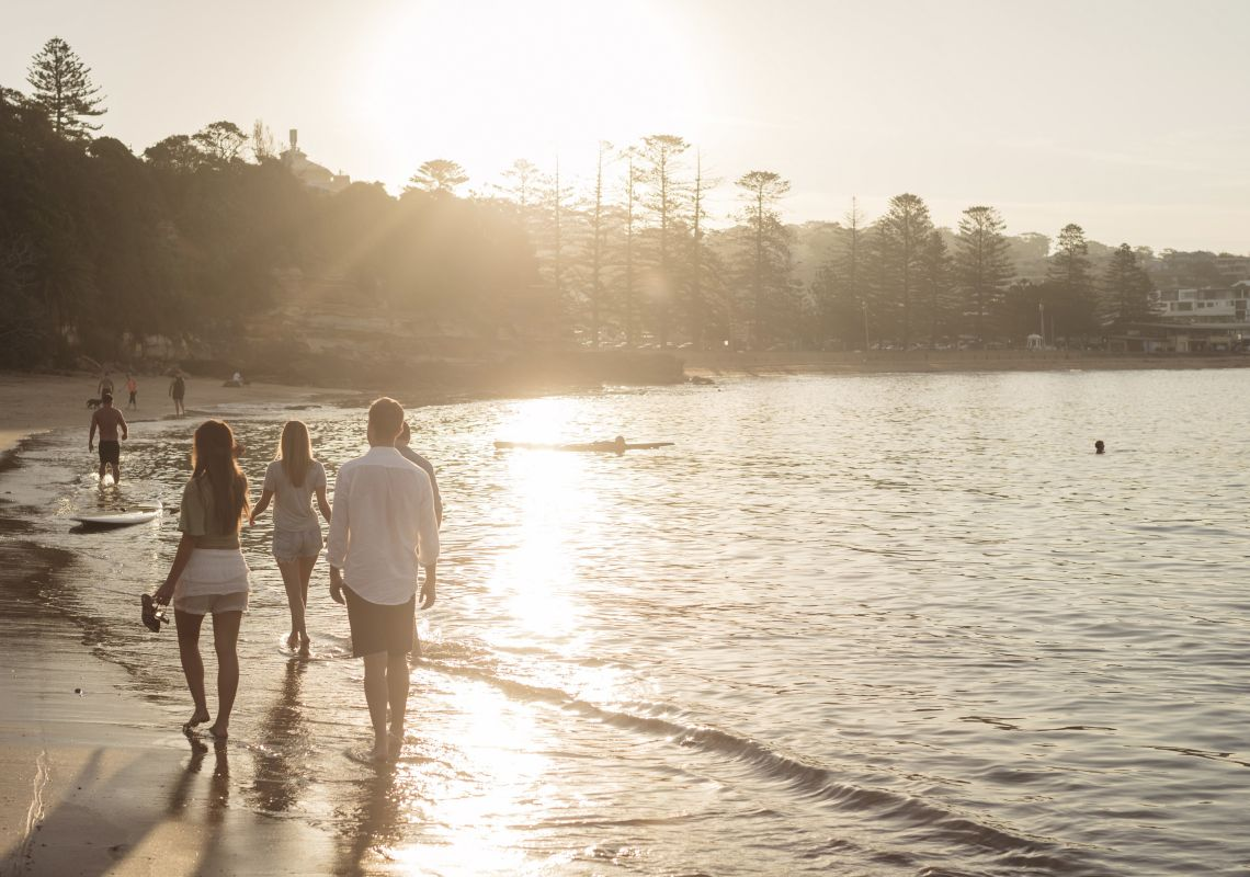 People enjoying the sunset by Terrigal Beach in Terrigal, Gosford