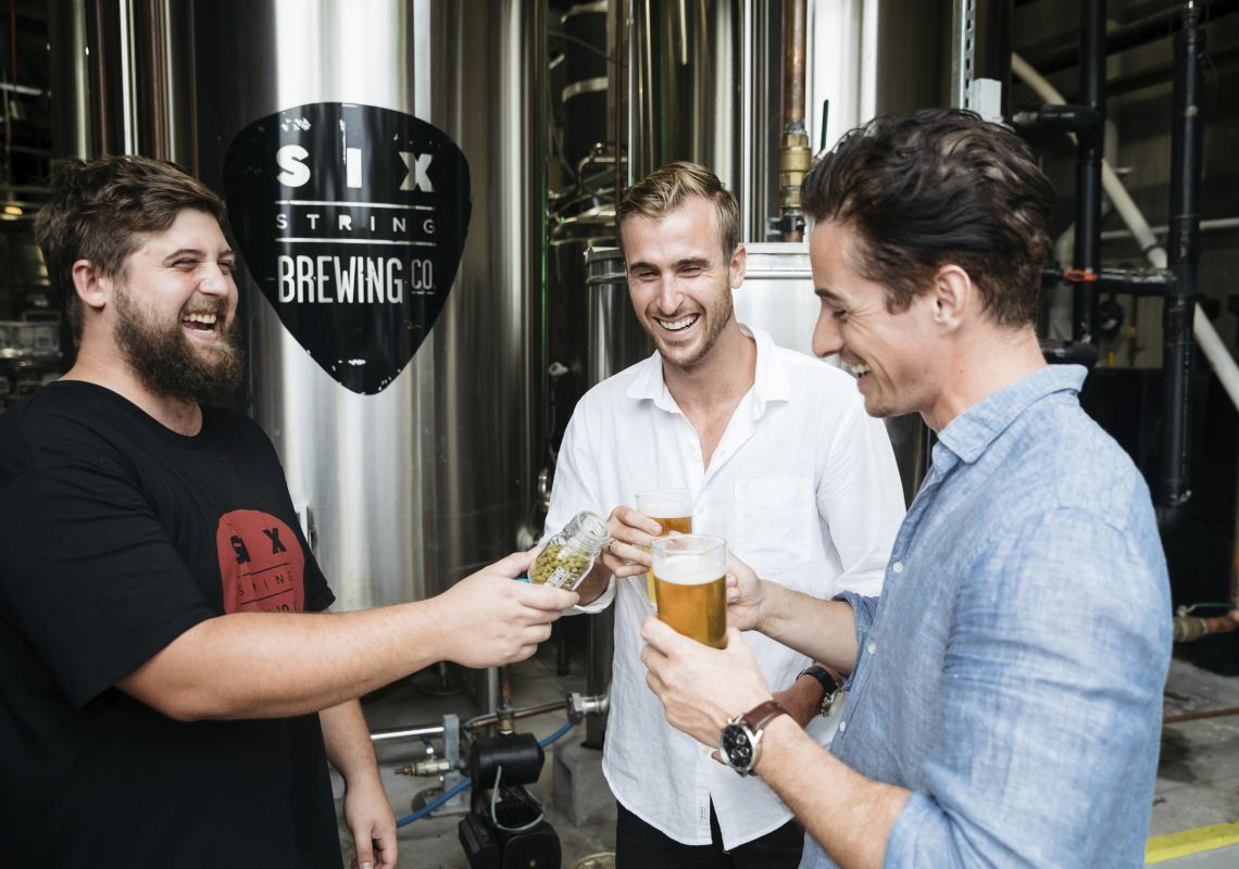 Friends enjoying a guided tour of the Six String Brewing Company brewery in Erina, Gosford