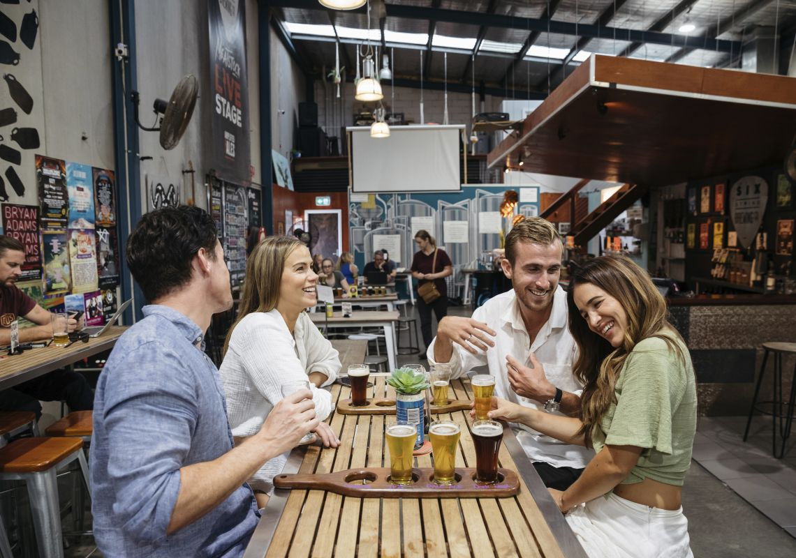 Friends enjoying beer tastings at the Six String Brewing Company brewery in Erina, Central Coast