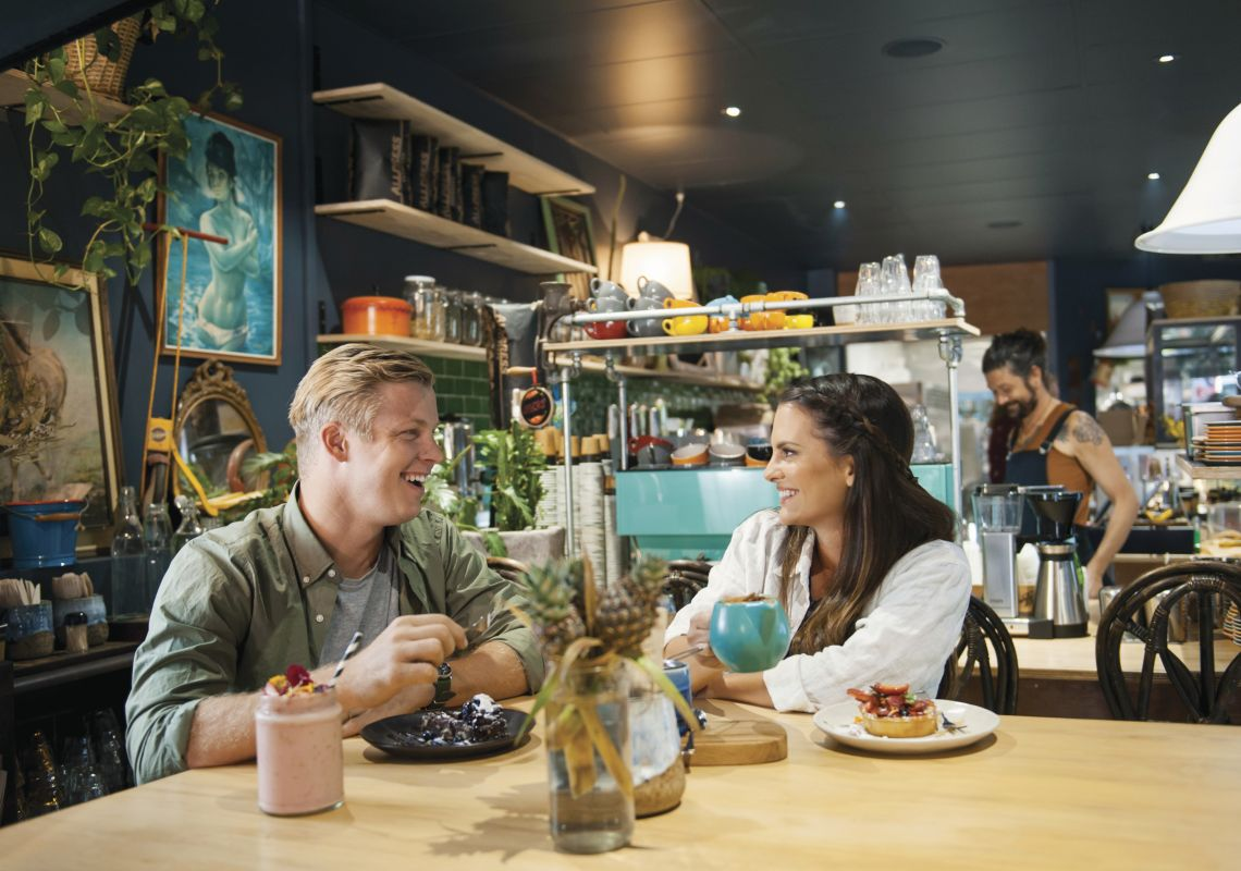 Couple enjoying food and drink at Flock Cafe, Lismore