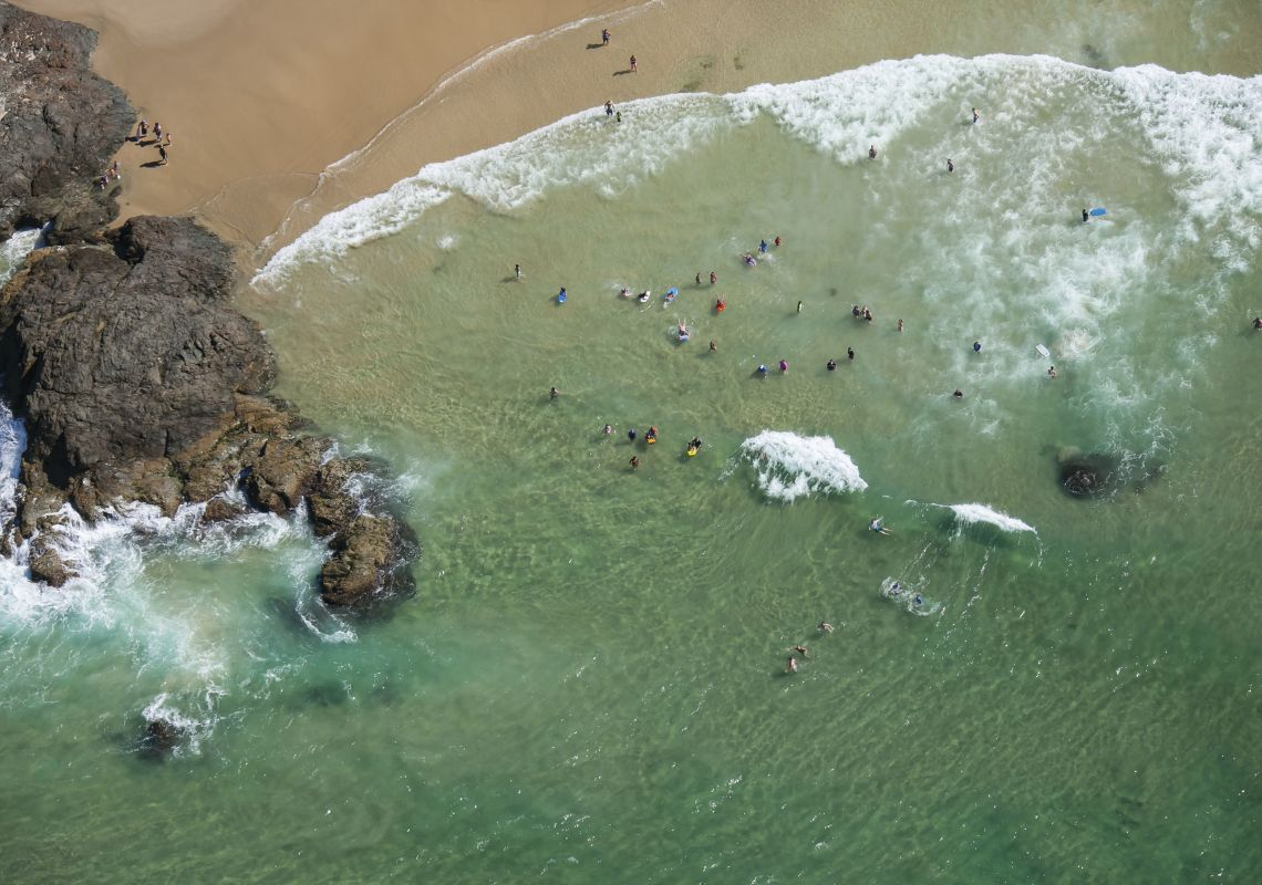 Aerial of people enjoying a sunny day at Town Beach in Port Macquarie, North Coast