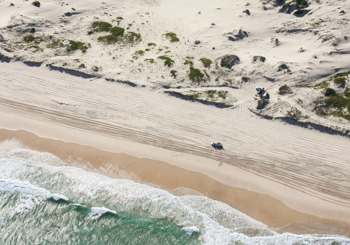 4WD driving along the beach on Worimi Conservation Lands, Port Stephens