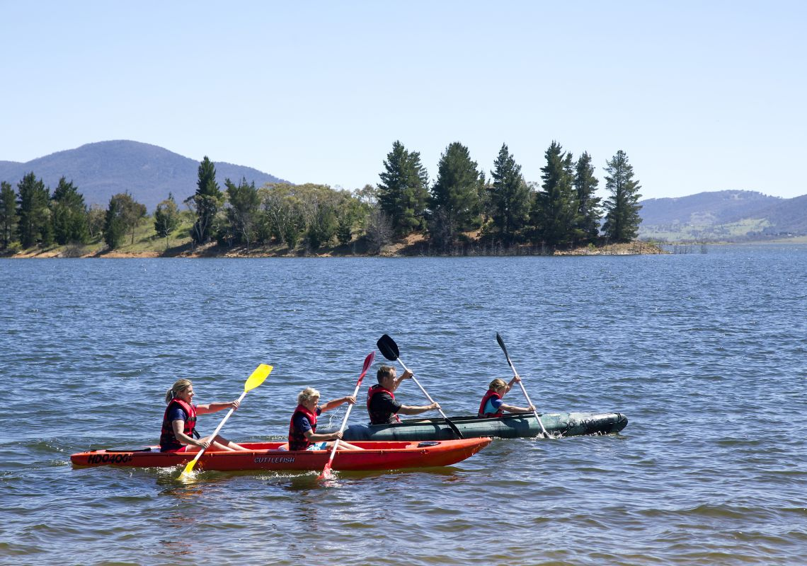 Family enjoying a scenic kayak on Lake Jindabyne in the Snowy Mountains