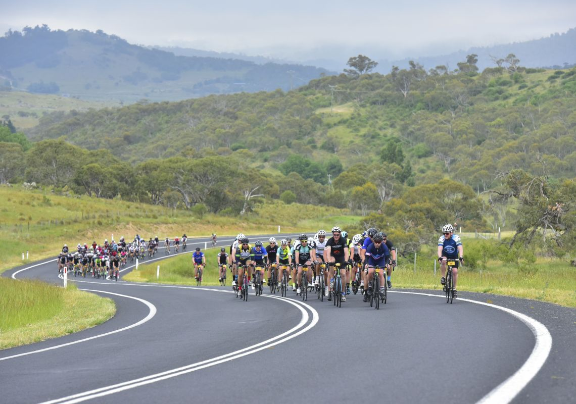Cyclists competing in the L'ɉtape Australia 2016 in the scenic Snowy Mountains