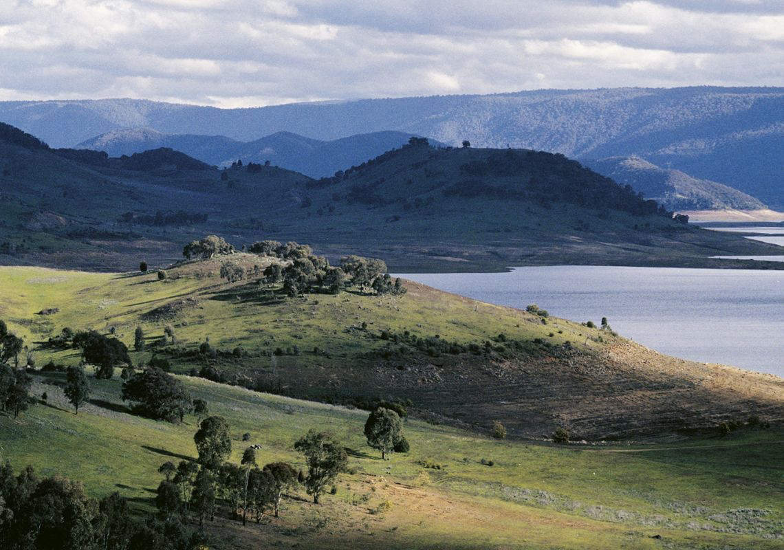 Long shot of country landscape with lake, Blowering reservoir, Snowy Mountains