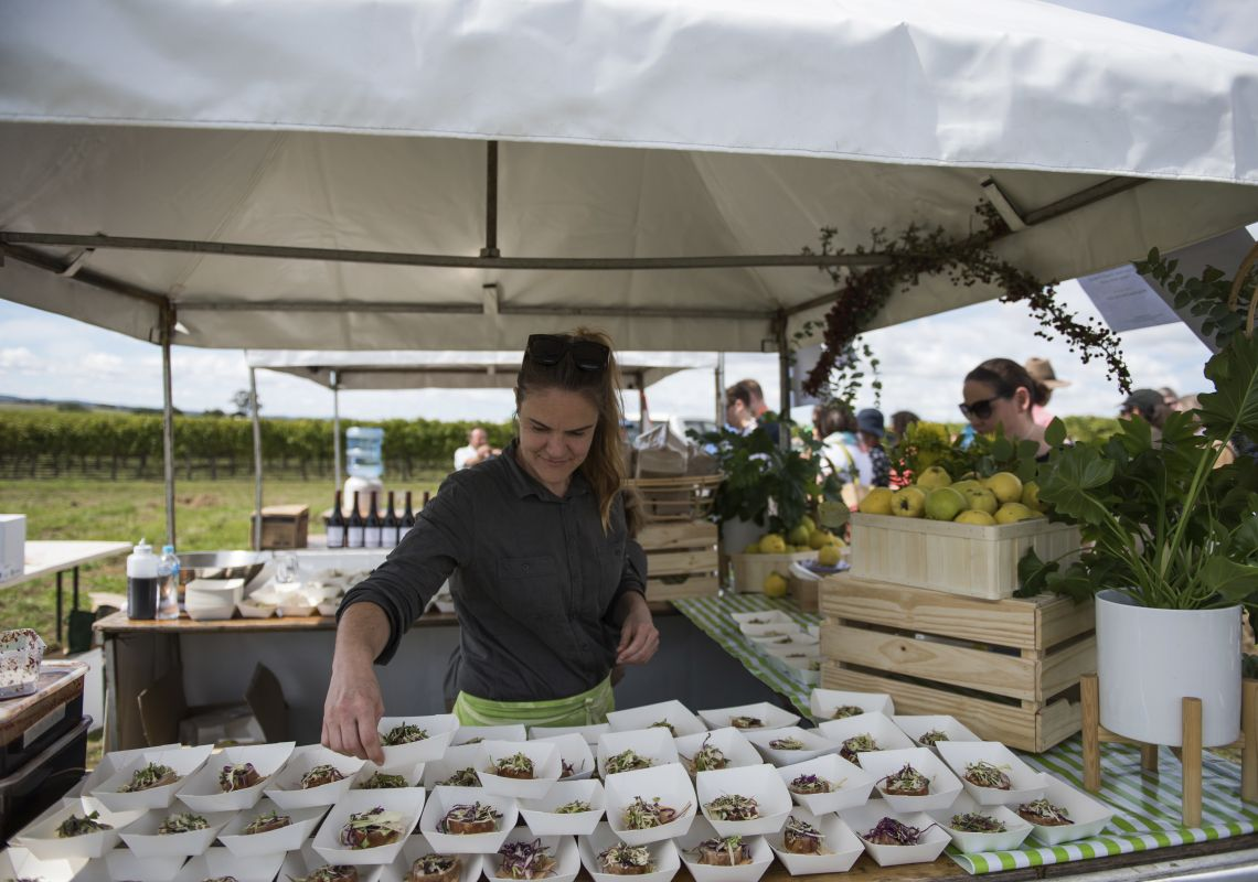 Representative at Groundstone food station preparing dishes during the FORAGE event at Orange F.O.O.D Week
