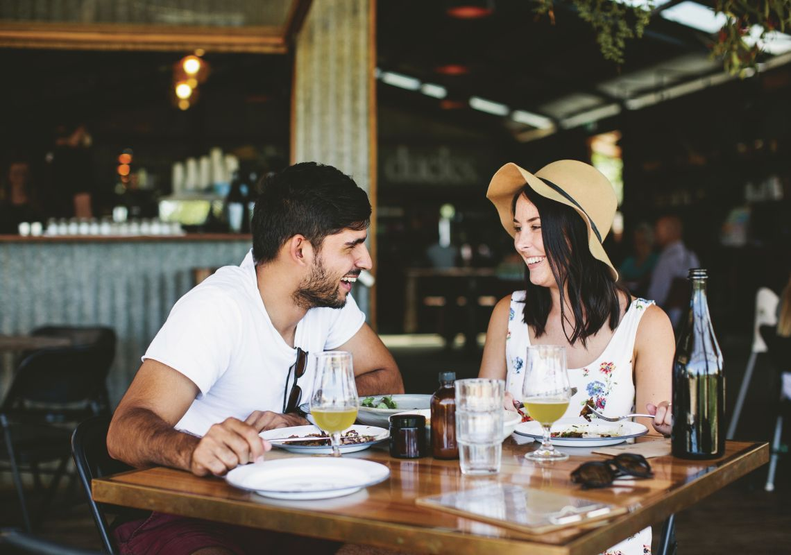 Couple enjoying food and drink at Three Blue Ducks restaurant and cafe at The Farm in Byron Bay, Sydney