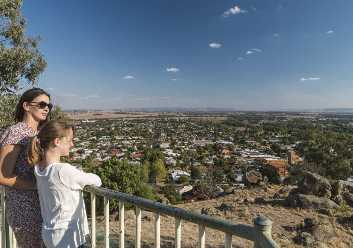 Family enjoying views overlooking Cowra from the Bellevue Hill Lookout, Cowra Area