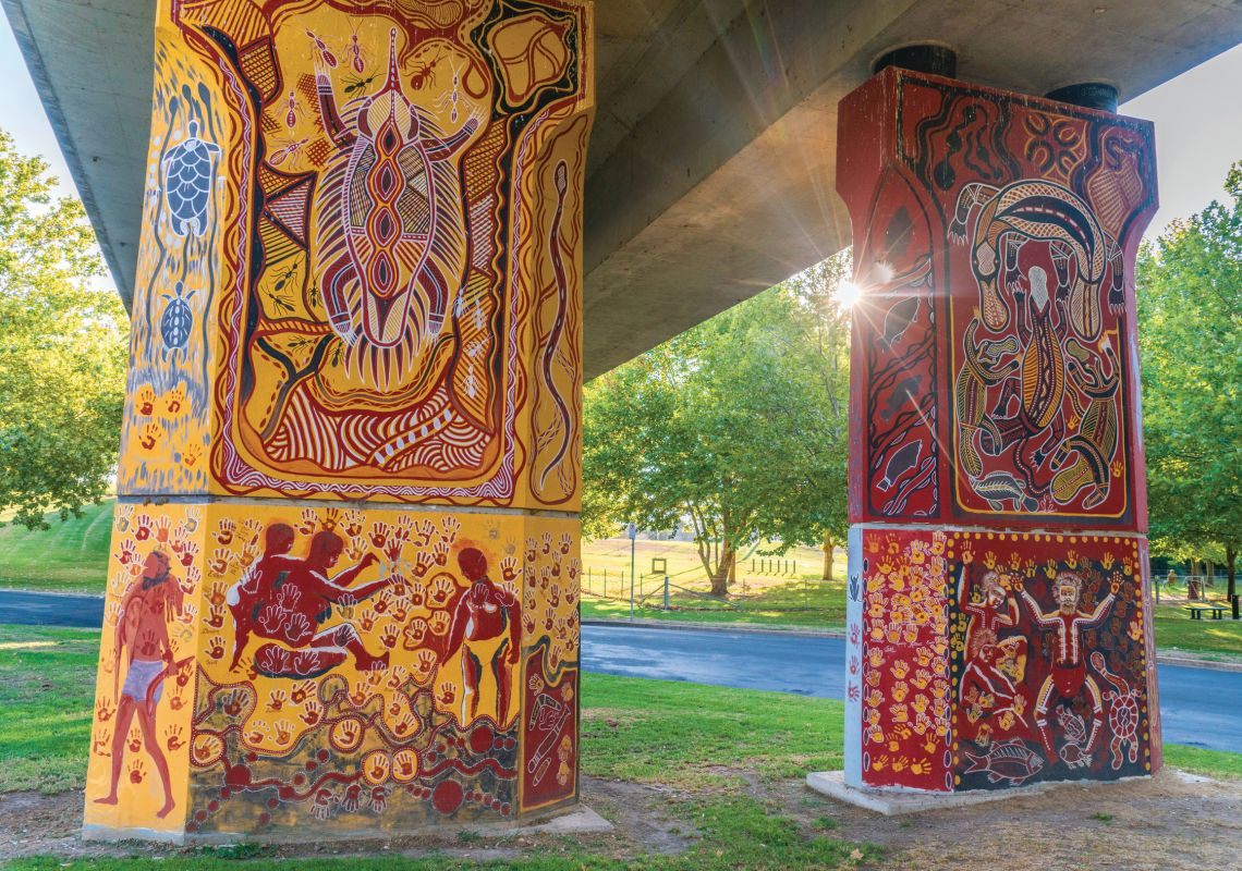Aboriginal murals painted by indigenous artist Kym Freeman on the Cowra Bridge Pylons located beneath the Lachlan River Bridge in Cowra, Country NSW
