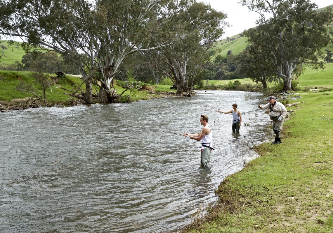 Friends enjoying a fly fishing lessons with guide Dave Ducker on the Goobarragandra River in Tumut,  Snowy Mountains
