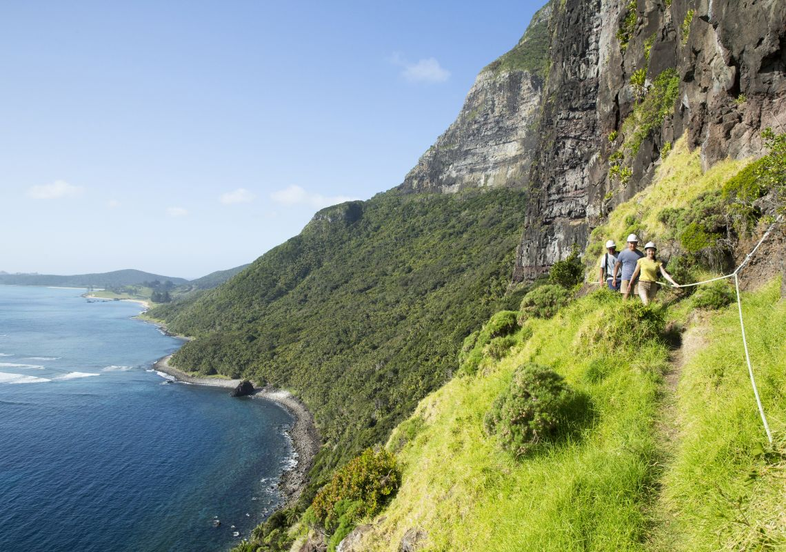 Couple enjoying a scenic hike up Mount Gower, Lord Howe Island