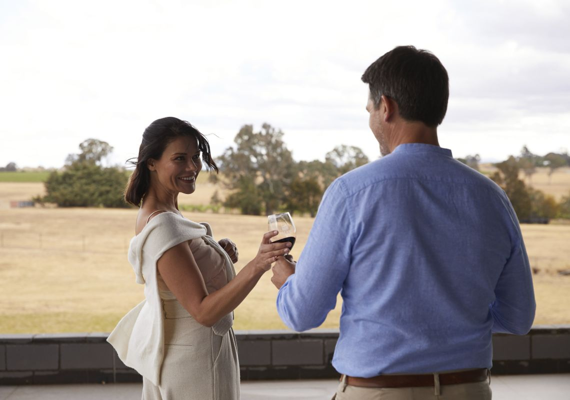 Couple enjoying a glass of wine at Shaw Wines in Murrumbateman, Yass Area