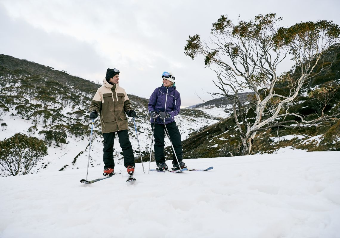 Couple skiing through Dead Horse Gap, Thredbo in the Snowy Mountains