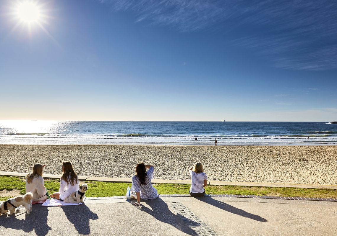 People relaxing at North Wollongong Beach in Wollongong