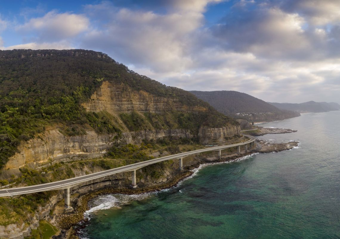 Aerial overlooking the scenic Sea Cliff Bridge in Clifton, Illawarra