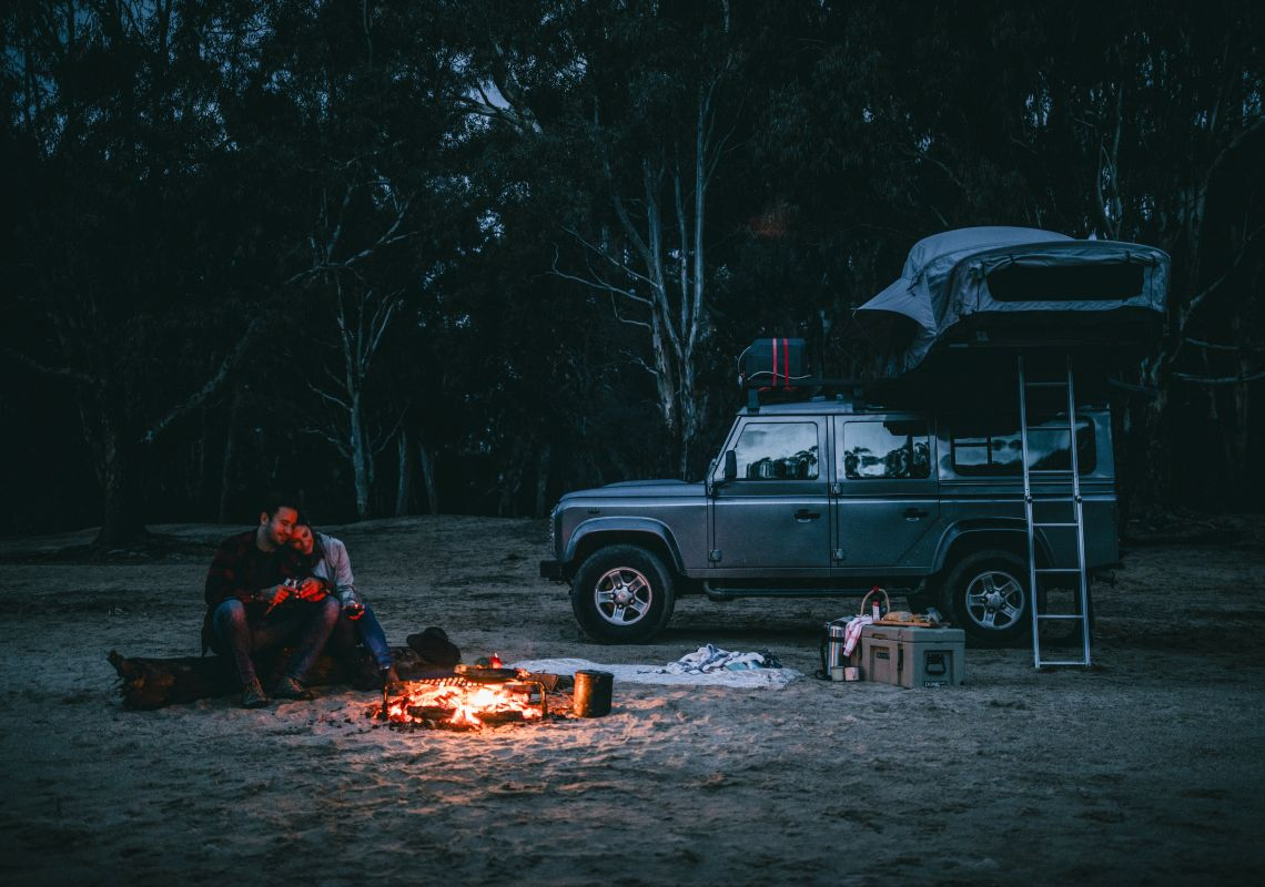 A couple enjoying a camping weekend away on the banks of the Murray River at Ulupna Island - The Murray - Country NSW