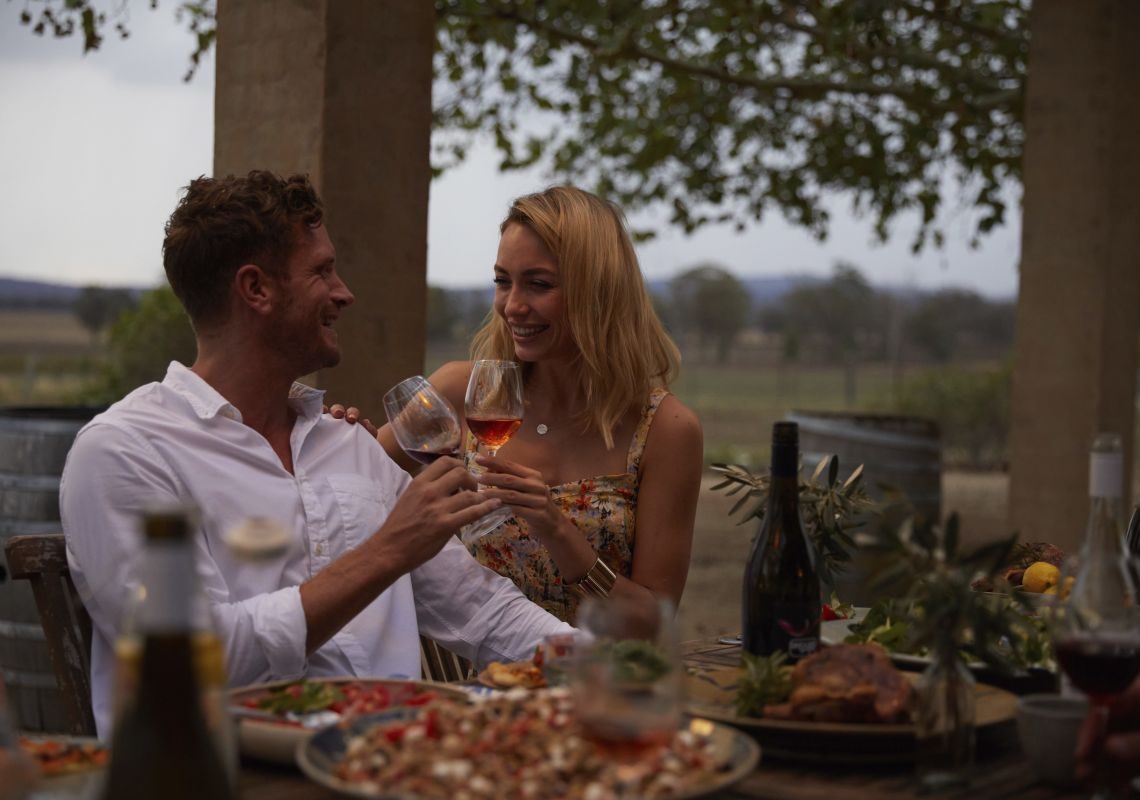Couple enjoying food and drink at Wallington Wines, Nyrang Creek