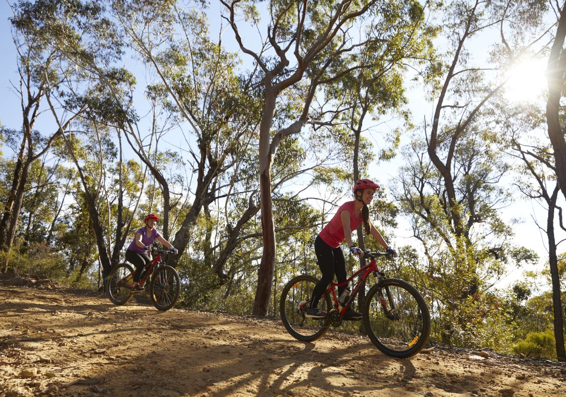 Mother and daughter enjoying a day of mountain biking in the Blue Mountains National Park, Blue Mountains
