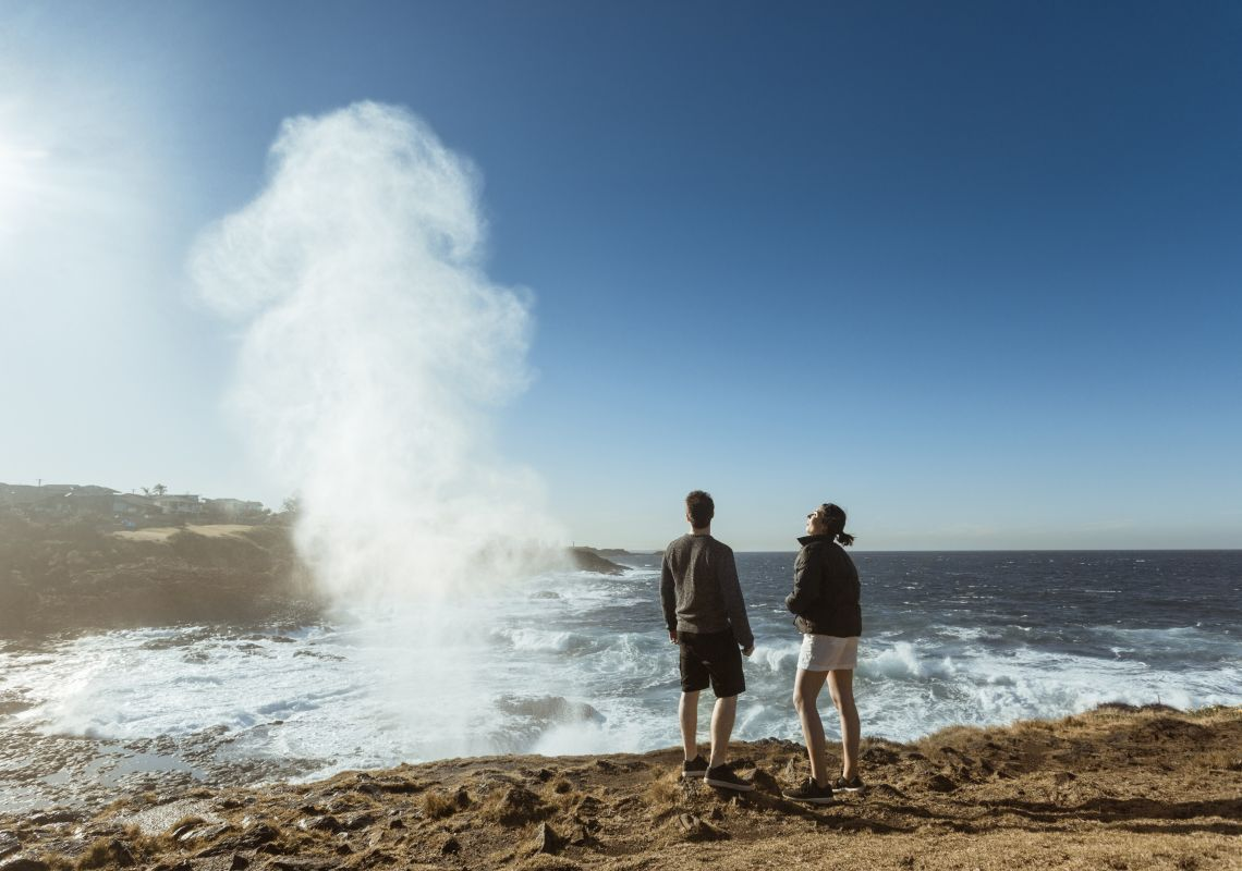 Couple watching the water plume from the Kiama blowhole
