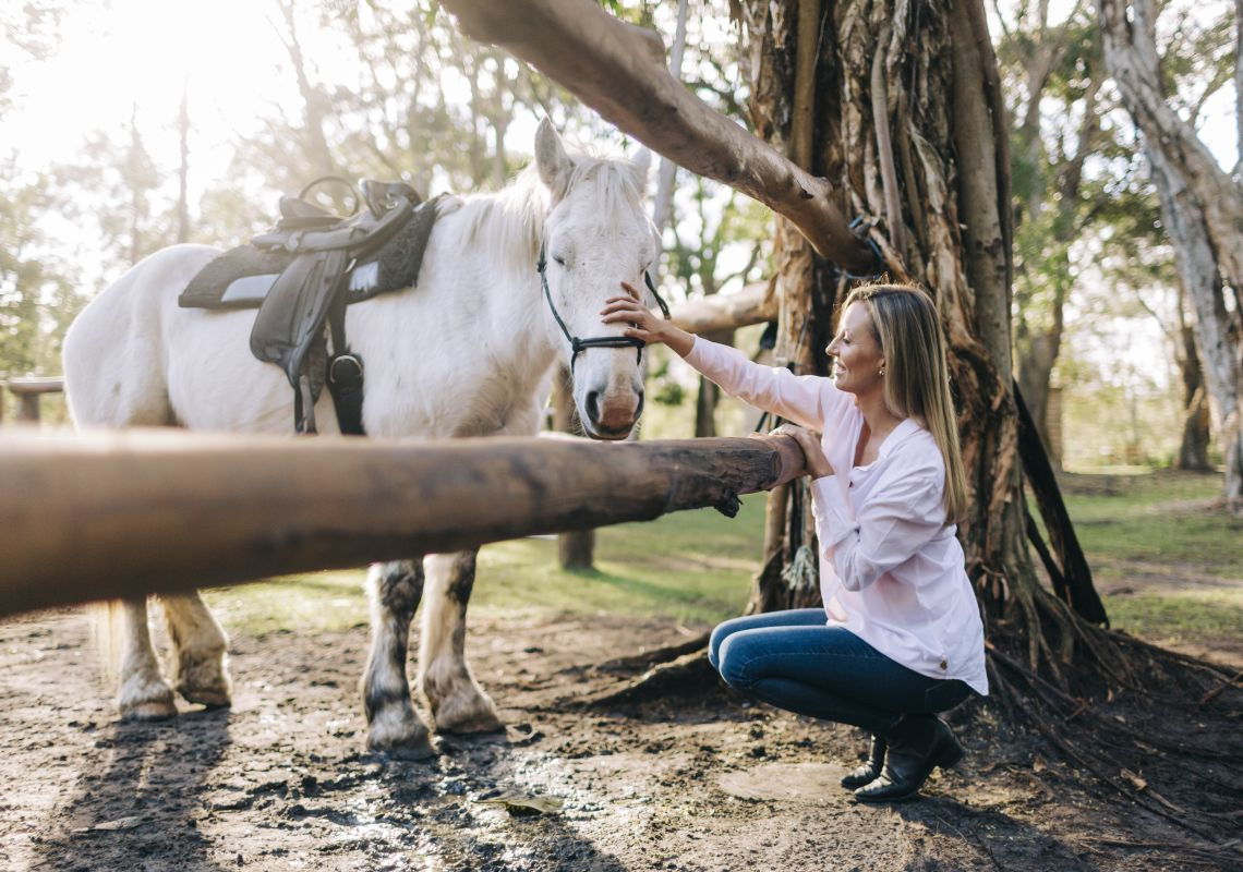 Woman meeting one of the horses at Zephyr Horses in Byron Bay, North Coast