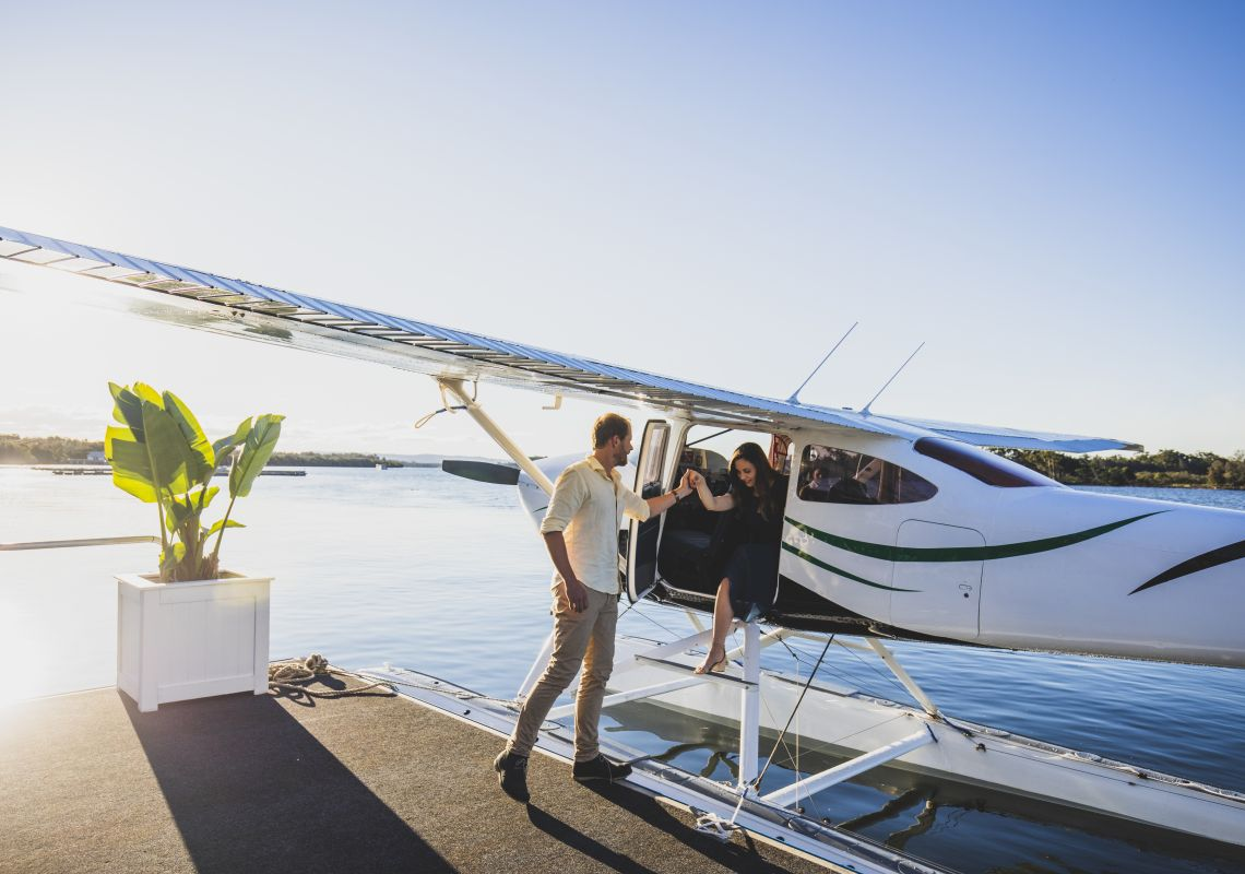 Guests arriving at Whalebone Wharf seafood restaurant by seaplane, Port Macquarie, North Coast
