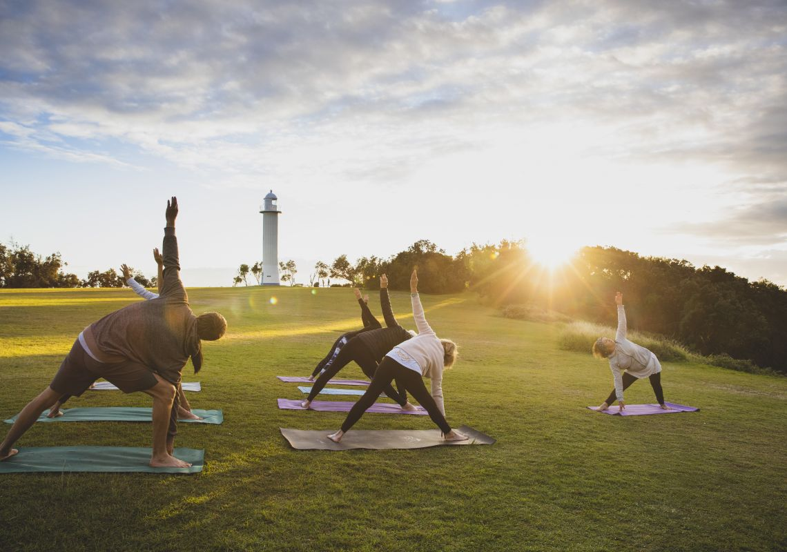 People enjoying a Yoga Room class in Wooli Park, Yamba, Clarence Valley