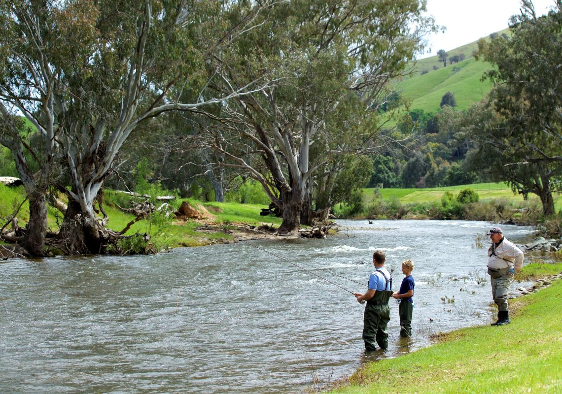 Father and son enjoying a fly fishing lessons with guide Dave Ducker on the Goobarragandra River, Tumut