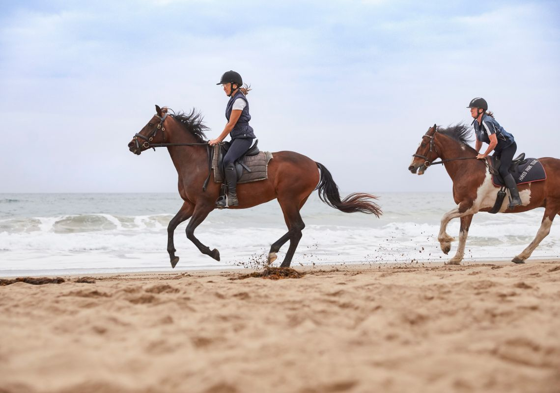 Guests at Bangalay Villas enjoying a beach horse ride experience on Seven Mile Beach, Shoalhaven Heads