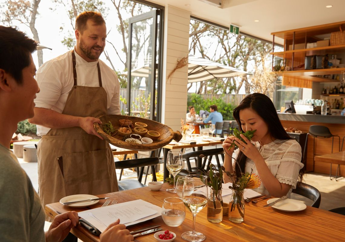 Chef Brett Strong showcasing the local and native ingredients featured on the Bangalay Dining menu to patrons, Shoalhaven Heads