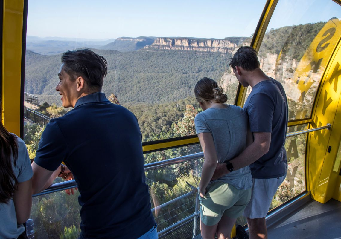 Visitors enjoying a ride over the Jamison Valley in the Scenic Skyway cable car in Katoomba