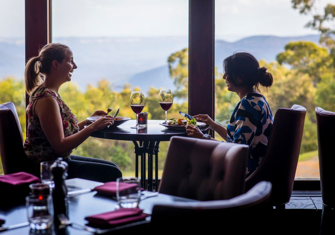 Women enjoying food and drink at Embers Restaurant inside the Fairmont Resort & Spa, Leura in the Blue Mountains