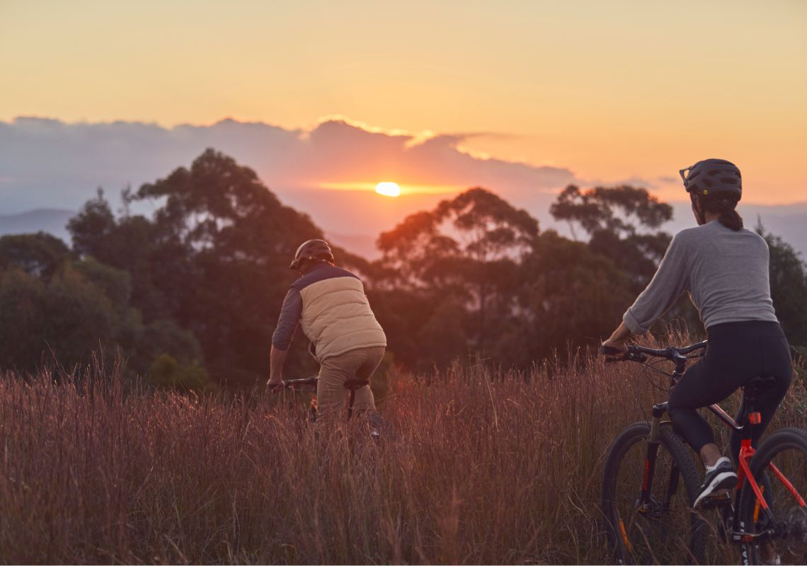 Couple enjoying an afternoon of mountain biking along the Big Bit Downhill track in Batemans Bay, South Coast
