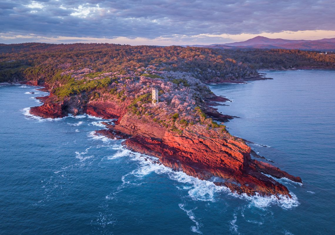 Sun rising over Boyd Tower on Red Point in the Ben Boyd National Park, Edrom, South Coast