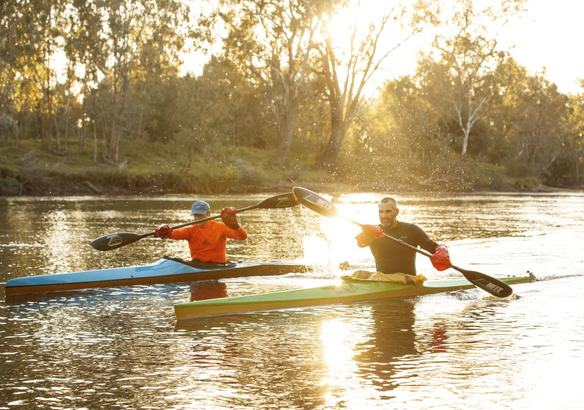 Friends enjoying a morning kayak along the Murray River in Albury, The Murray