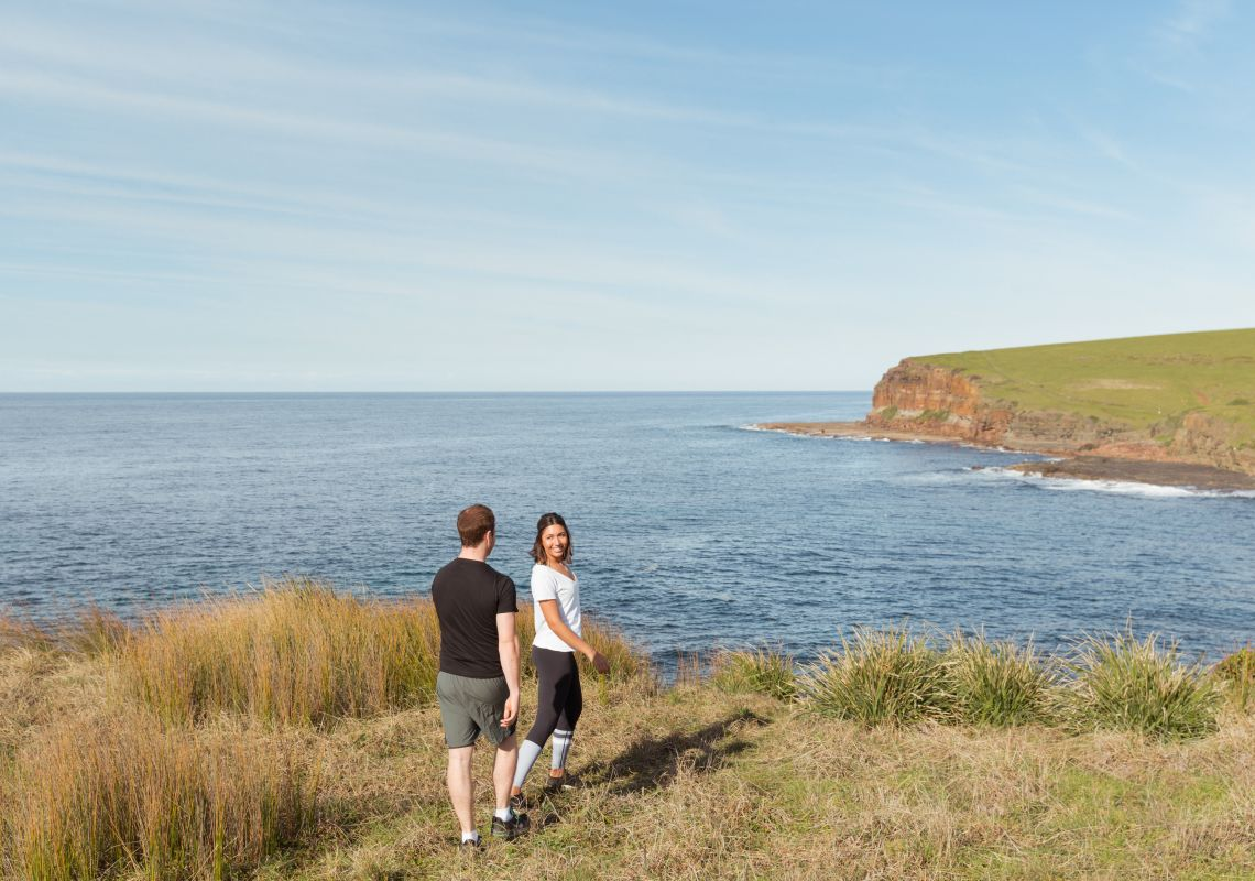 Couple enjoying a walk along the Kiama Coastal Walk on the South Coast