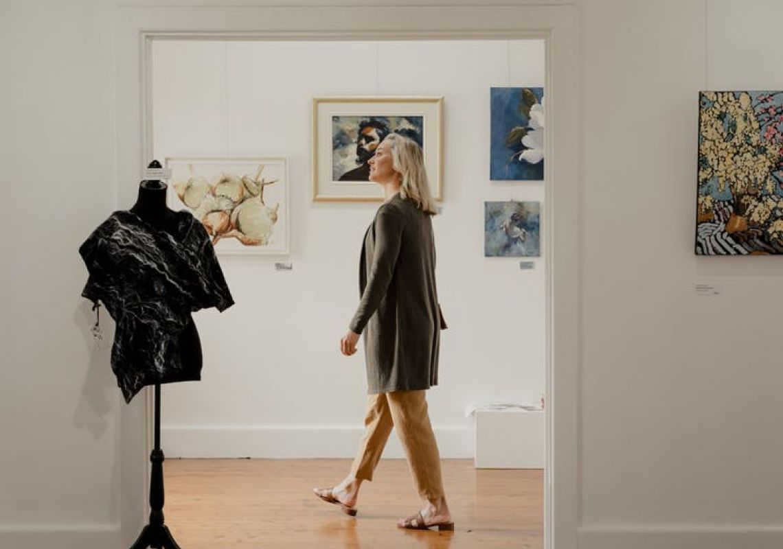 A woman visiting white art gallery at Shearing the Rams Trail, Corowa, The Murray, Country NSW