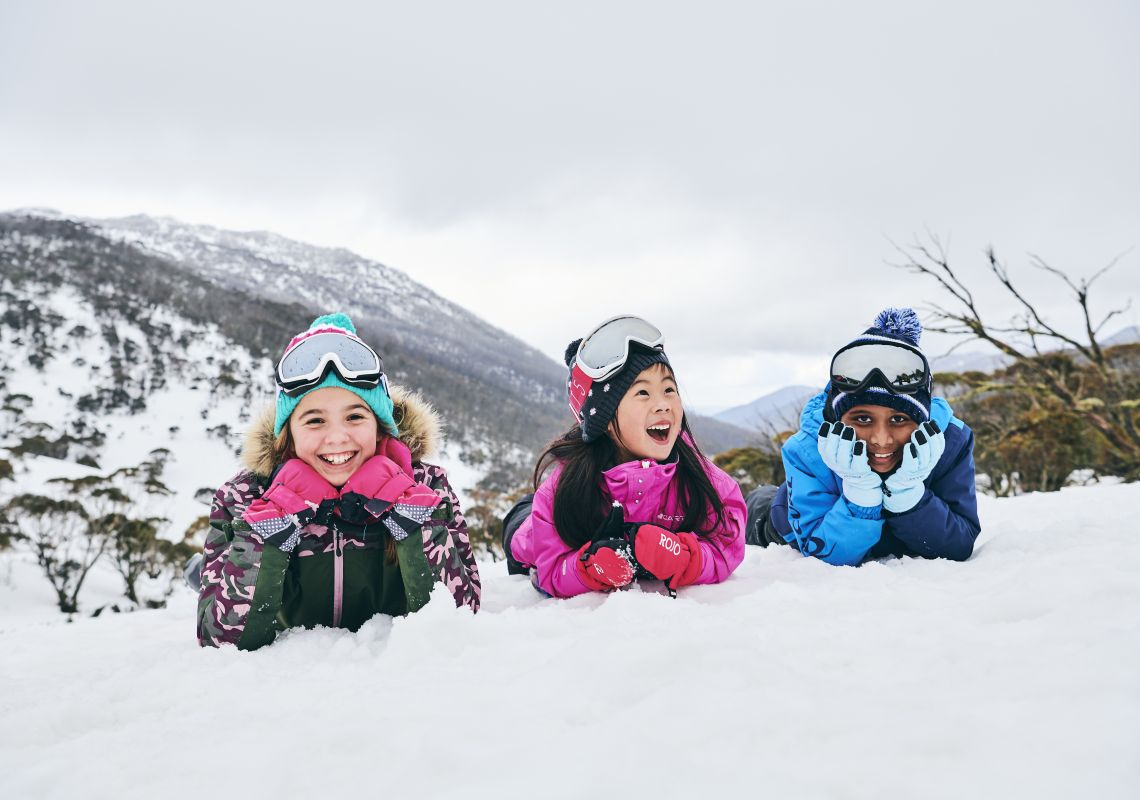 Children enjoying a fun day in the snow at Thredbo in the Snowy Mountains