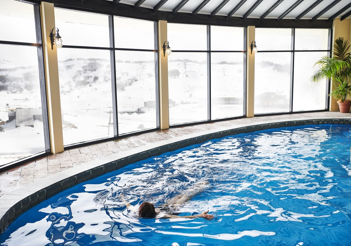 Woman enjoying a swim at Perisher's only heated pool in the Marritz Hotel, Perisher, Snowy Mountains