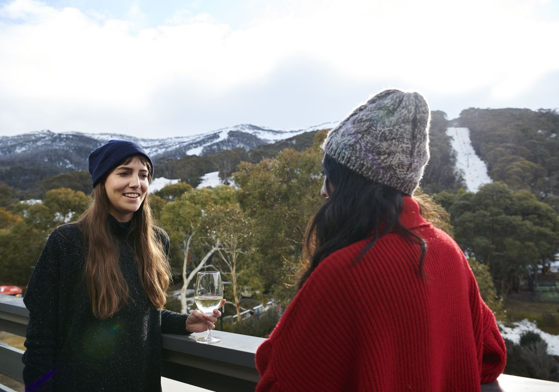 Women enjoying a glass of wine at The Local Pub in Thredbo Village, Snowy Mountains
