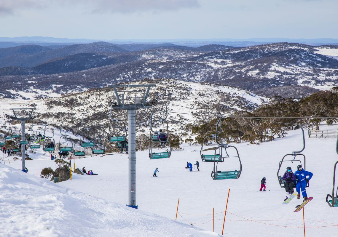 People enjoying a day of skiing and snowboarding at Blue Cow ski resort in Perisher, Kosciuszko National Park