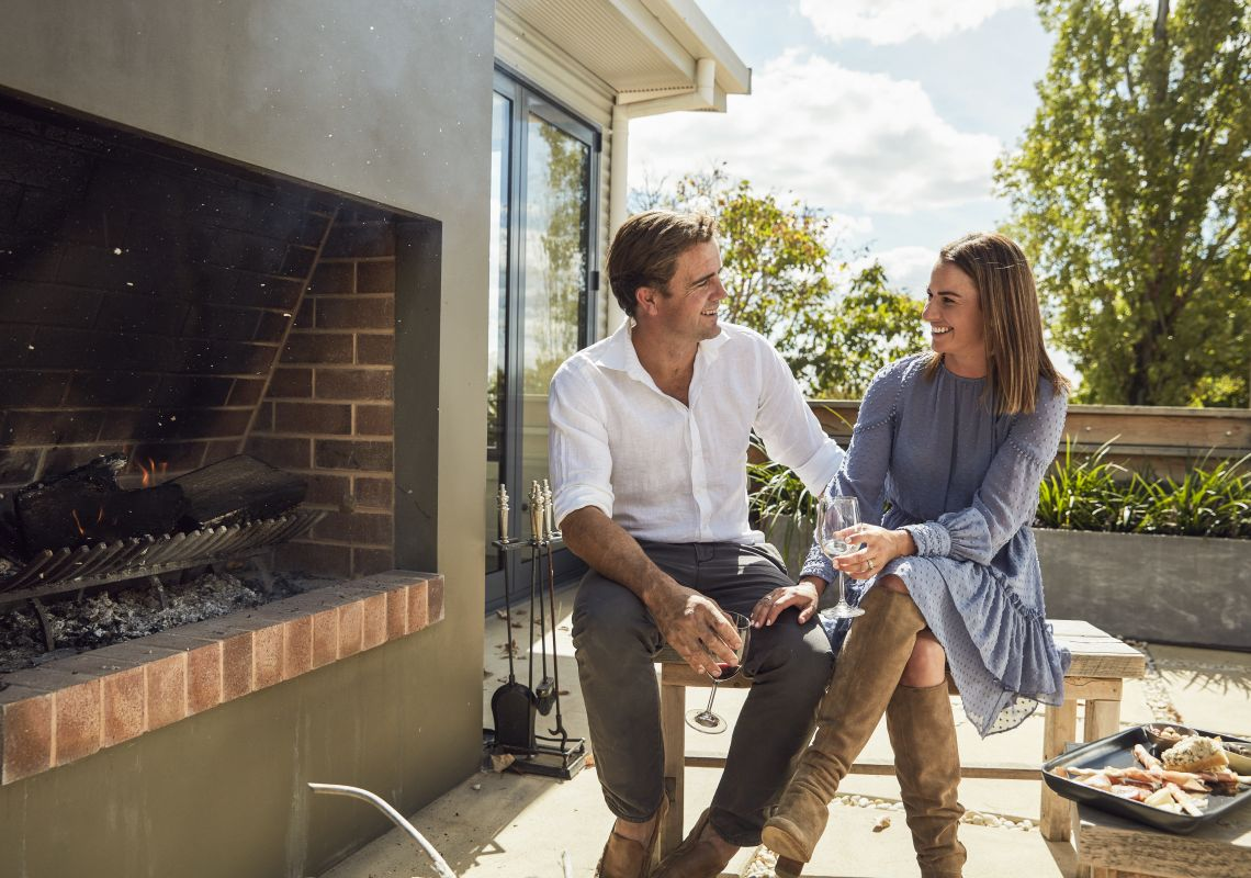 Couple enjoying the outdoor fireplace at Ross Hill Wines in Orange, Country NSW