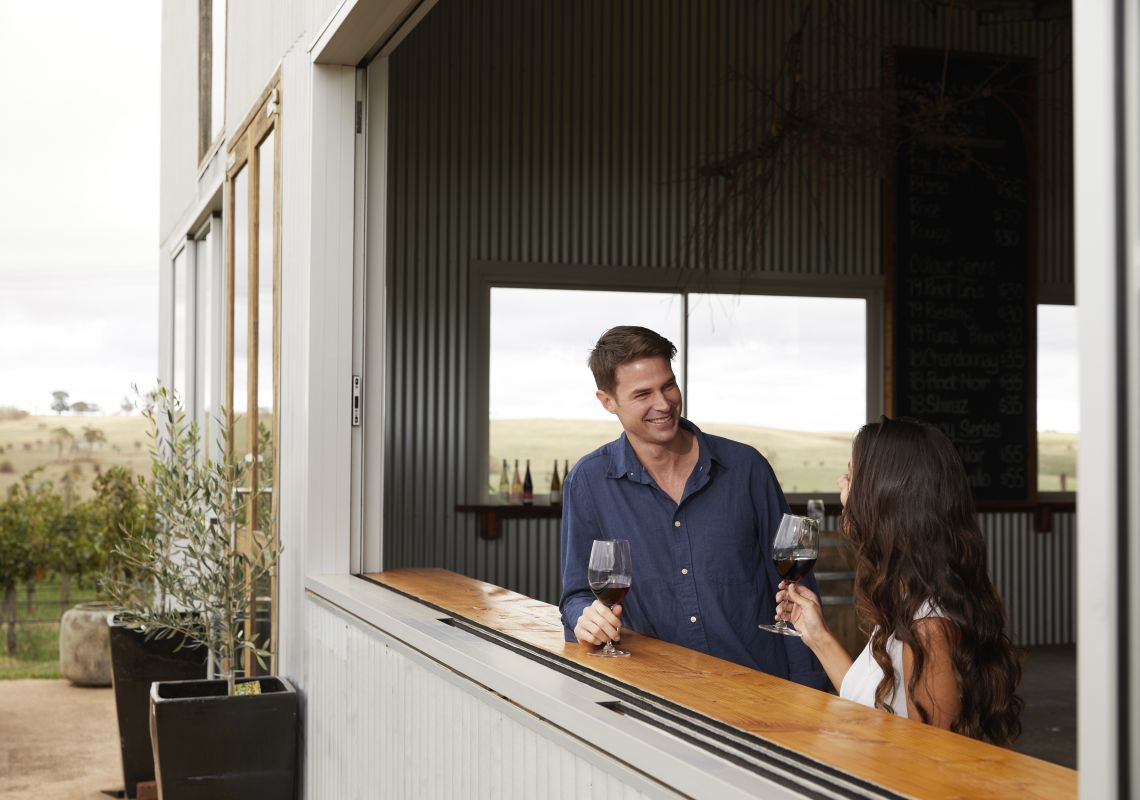 Couple enjoying a glass of red wine from Nashdale Lane Wines, Nashdale, Orange Area