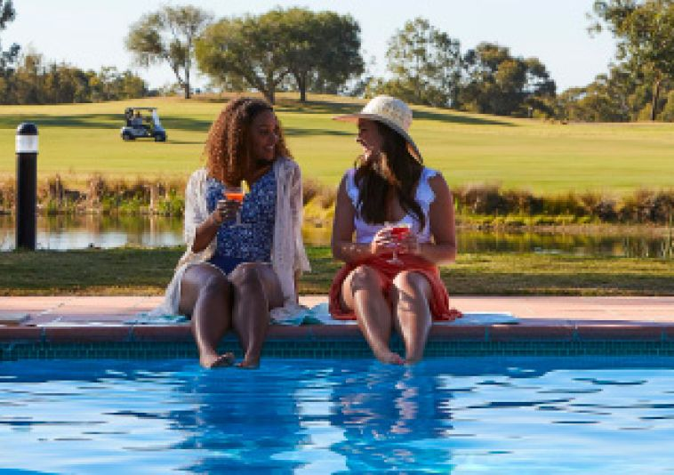 Friends by the pool at Oaks Cyprus Lakes Golf Resort