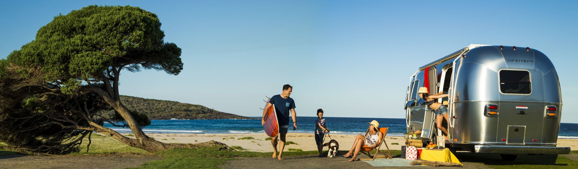 A family caravanning at Merry Beach in Kioloa, South Coast