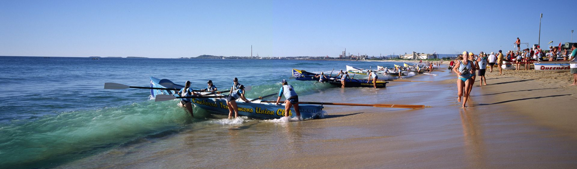 Surfboat crews preparing to race, Wollongong City Beach
