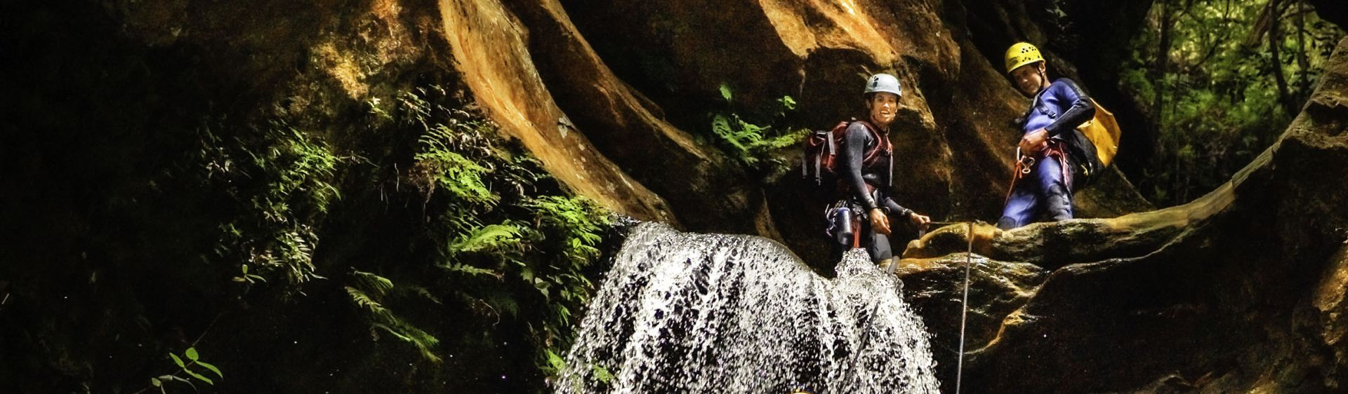 Two men abseiling at Empress Falls in the Blue Mountains
